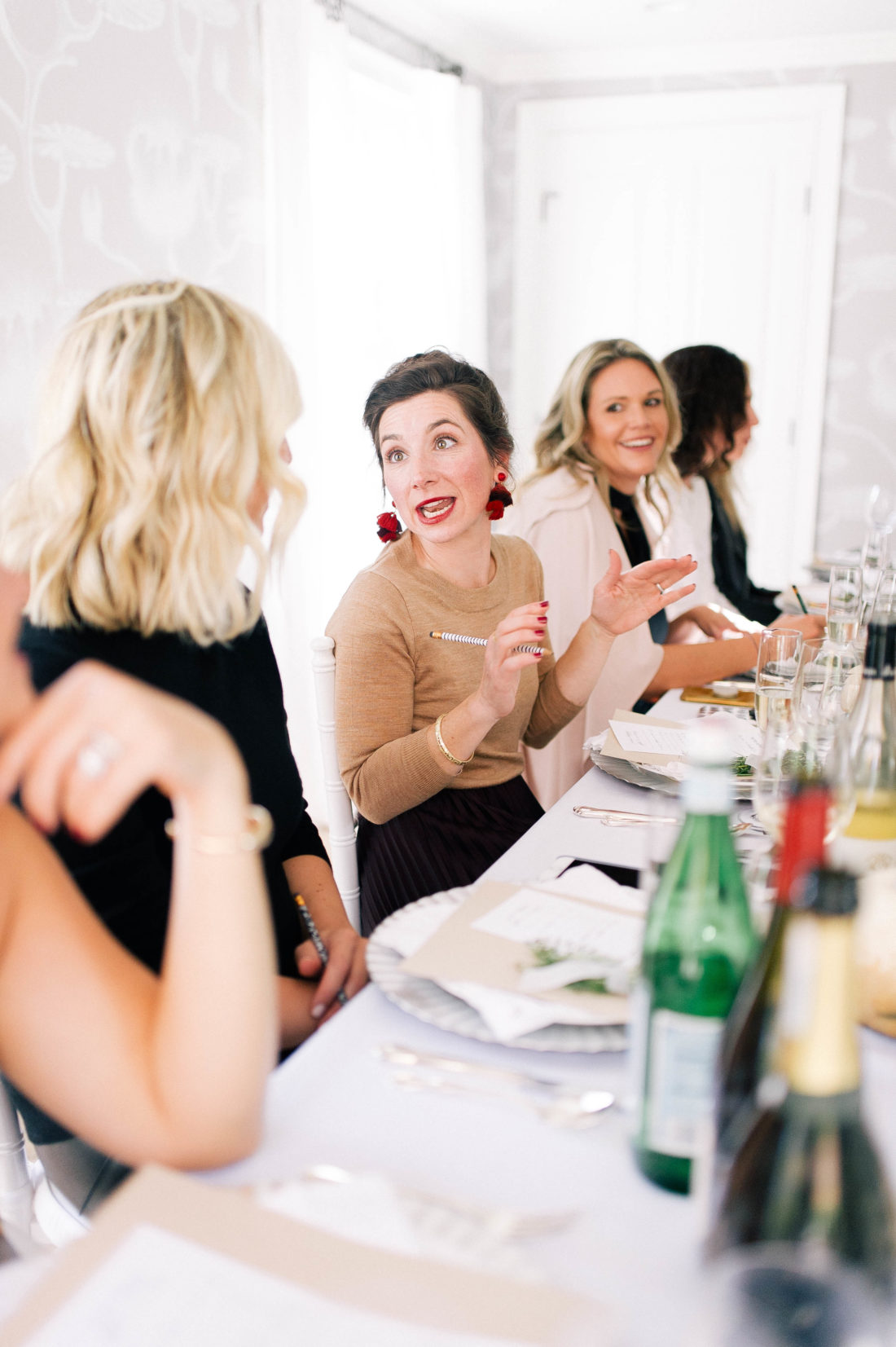 guests eat and chat at Eva Amurri Martino's Friendsgiving at her Connecticut home