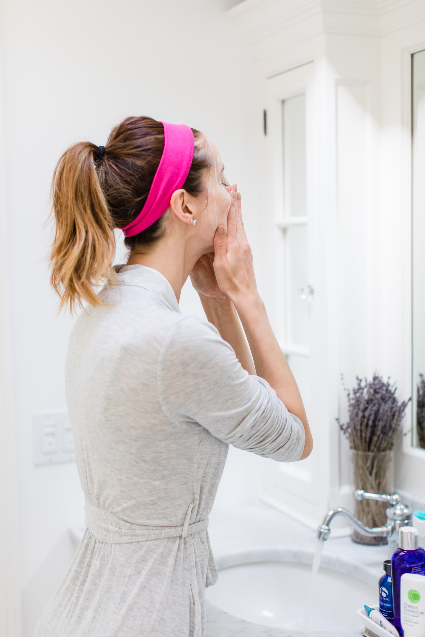 Eva Amurri Martino cleanses her face in the bathroom of her Connecticut home