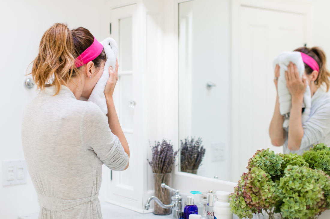 Eva Amurri Martino dries her face off after cleansing her skin