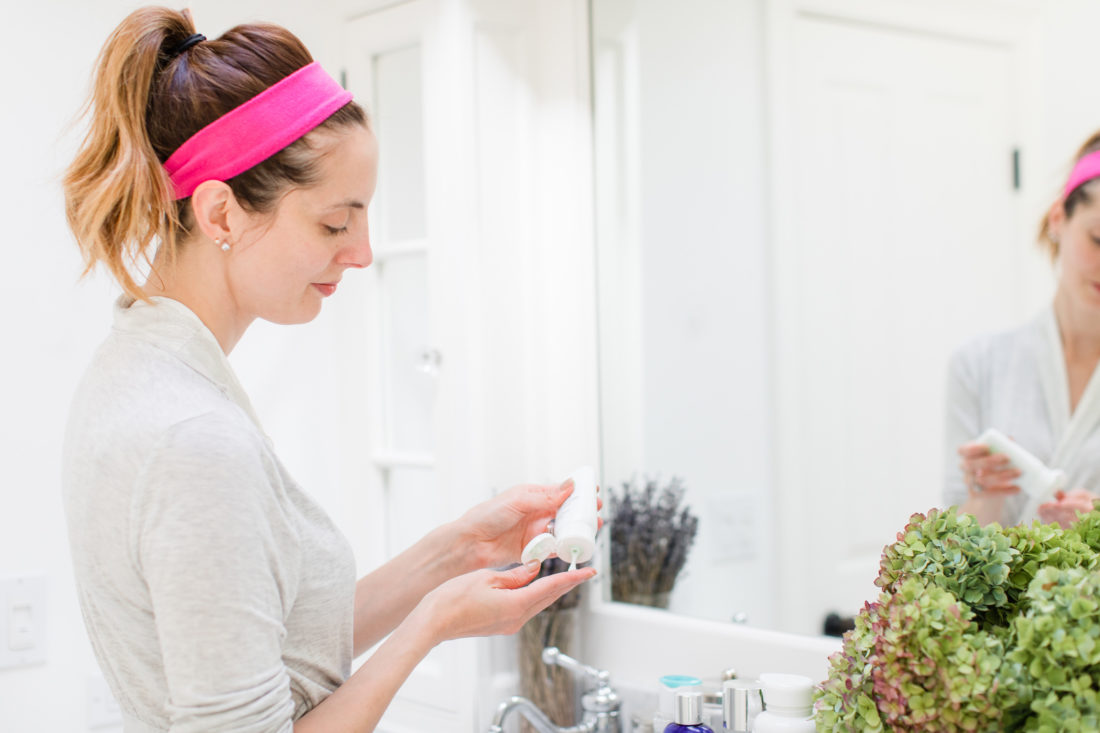Eva Amurri Martino applies facial moisturizer as part of her night time skincare routine