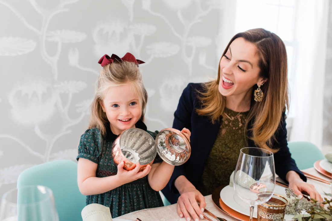 Marlowe Martino shows the inside of a copper pumpkin at the Thanksgiving table in her Connecticut home