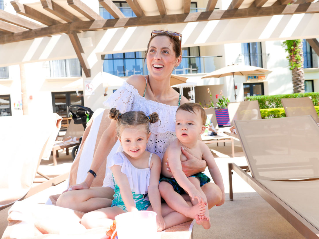 Eva Amurri Martino sits with her two children by the pool at the Hyatt Ziva resort in los cabos, Mexico