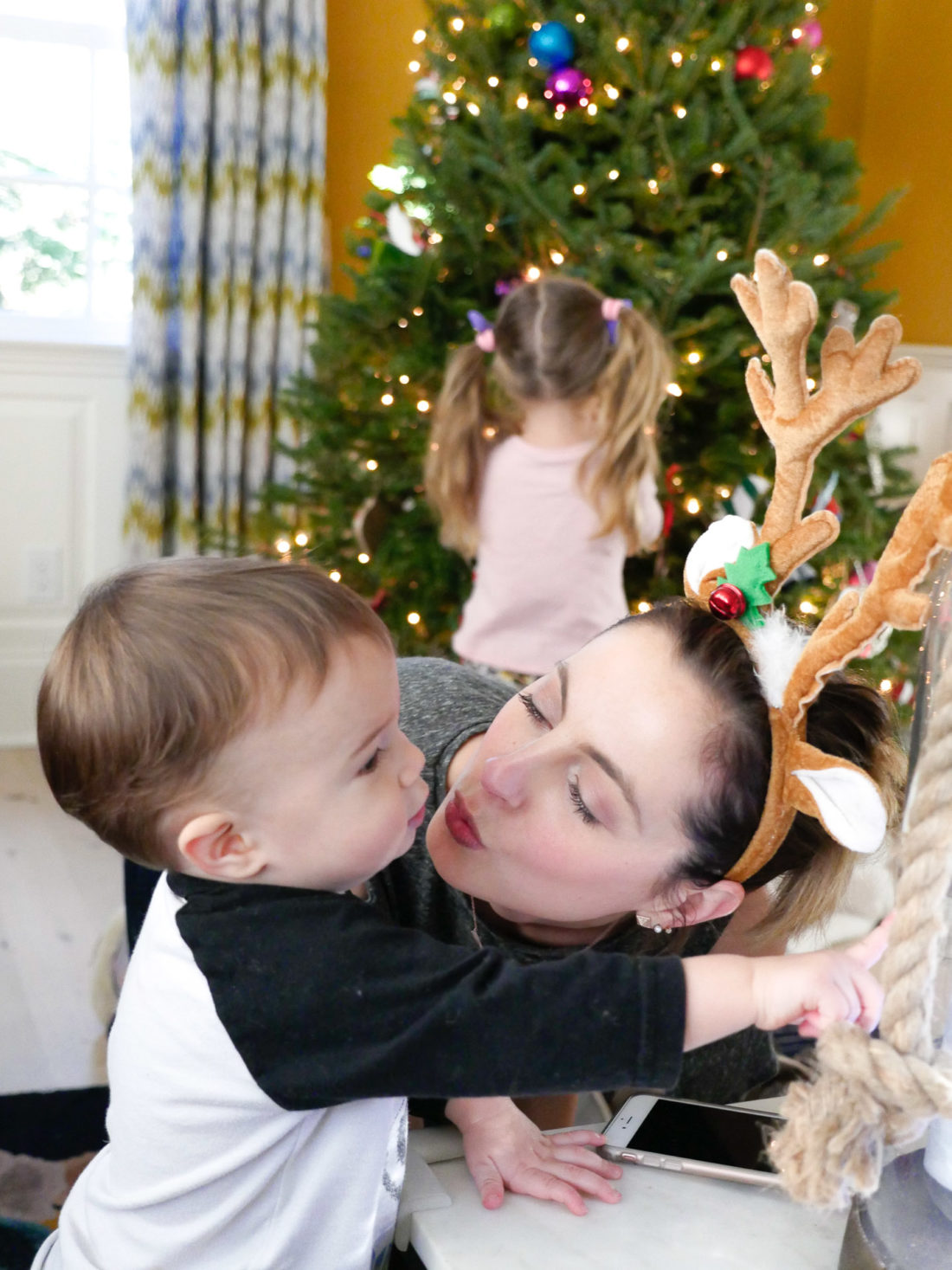 Eva Amurri Martino kisses son Major while they decorate the family Christmas tree