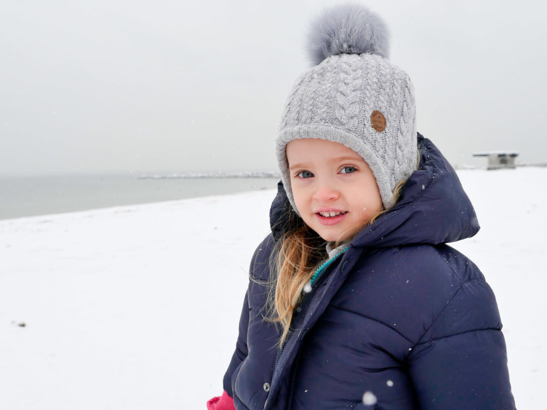 Marlowe Martino stands on the beach in the snow in Westport CT