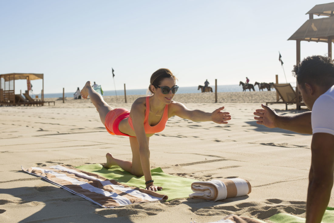 Eva Amurri Martino does yoga on the beach in los cabos, Mexico