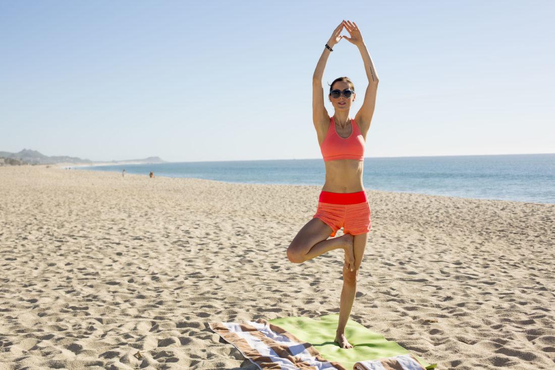 Eva Amurri Martino does yoga on the beach in los cabos, Mexico