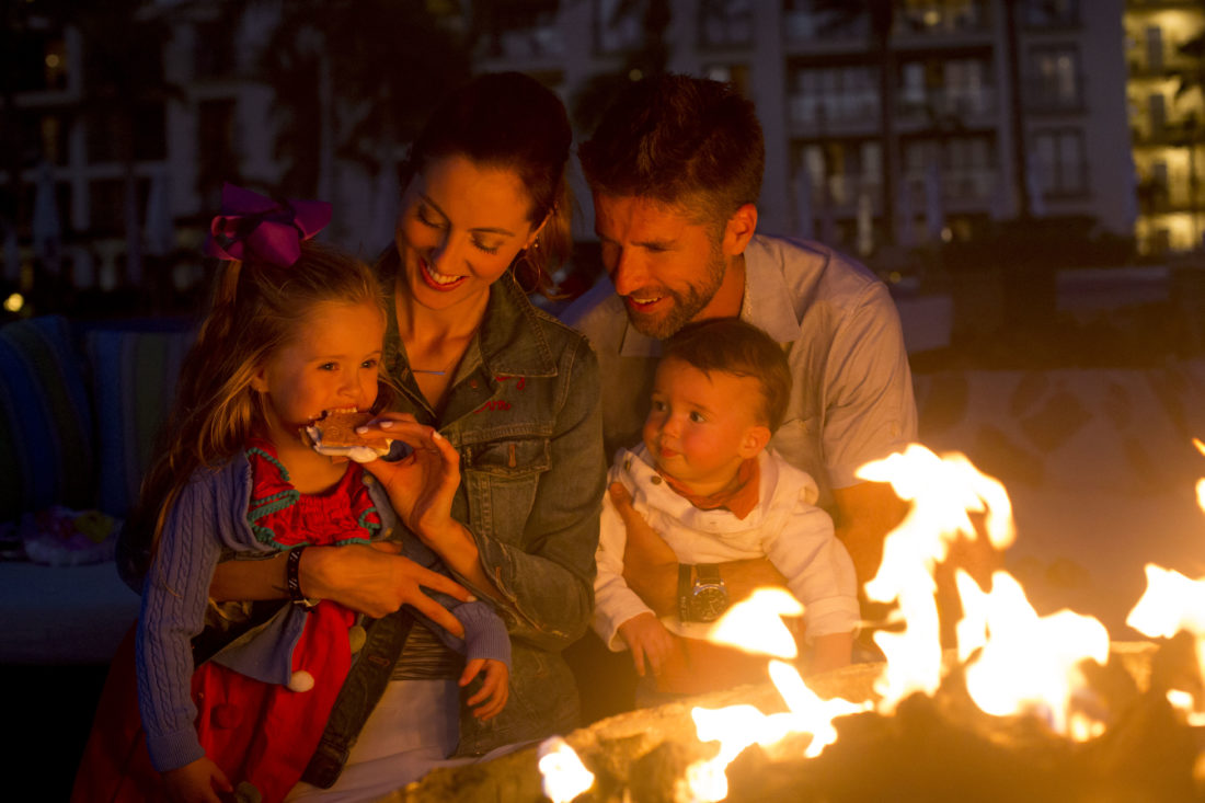 Eva Amurri Martino, Kyle Martino, Marlowe Martino, and Major Martino make s'mores on the beach in los cabos Mexico