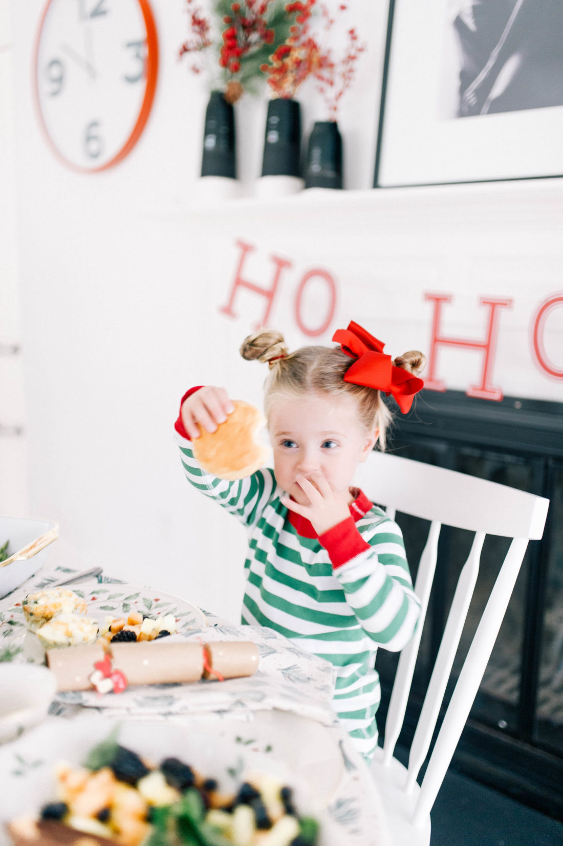 Marlowe Martino holds up a buttermilk biscuit at her family's christmas day brunch at home in Connecticut