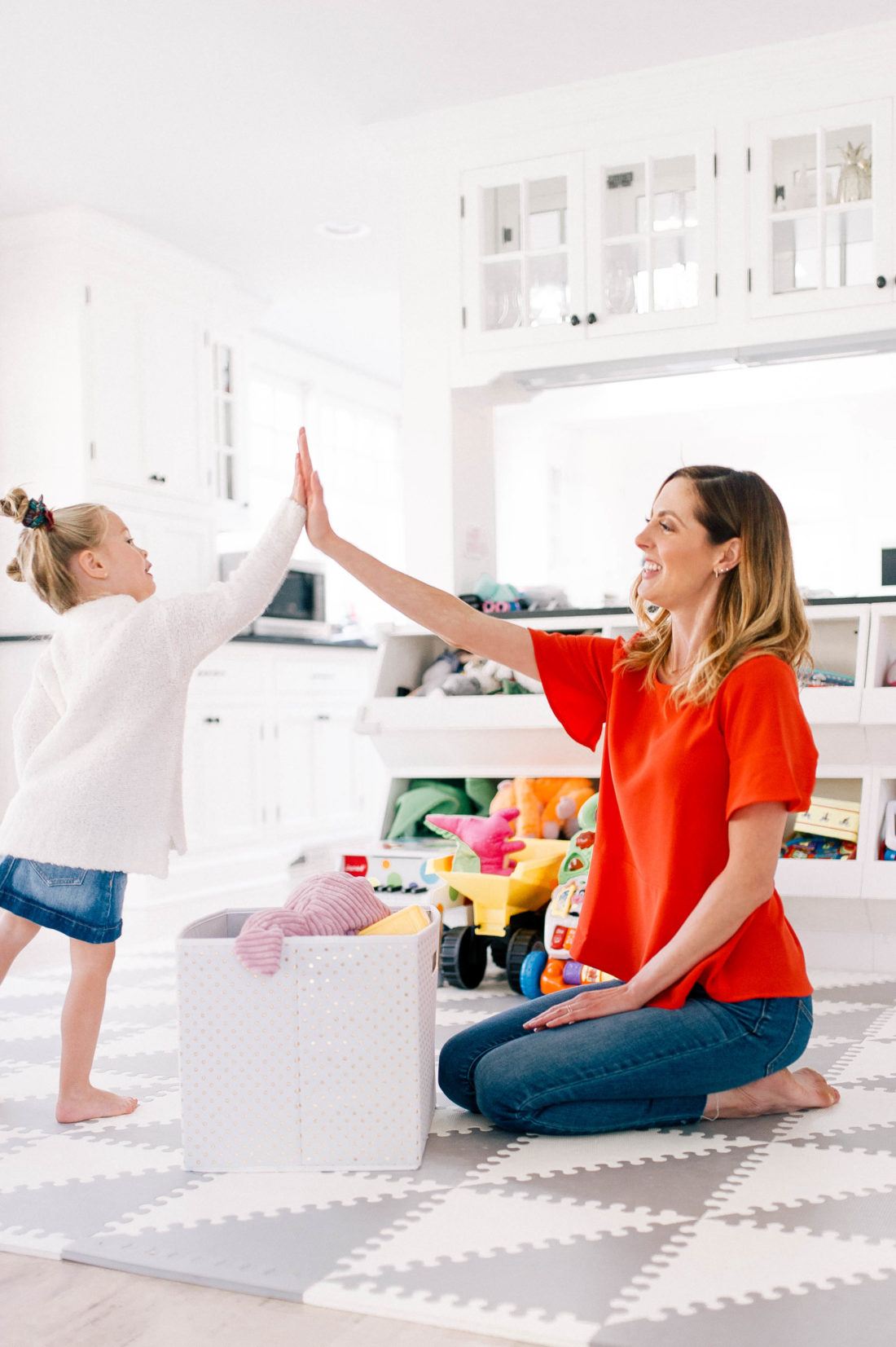 Eva Amurri Martino high fives daughter Marlowe after she chooses toys to give away to children in need