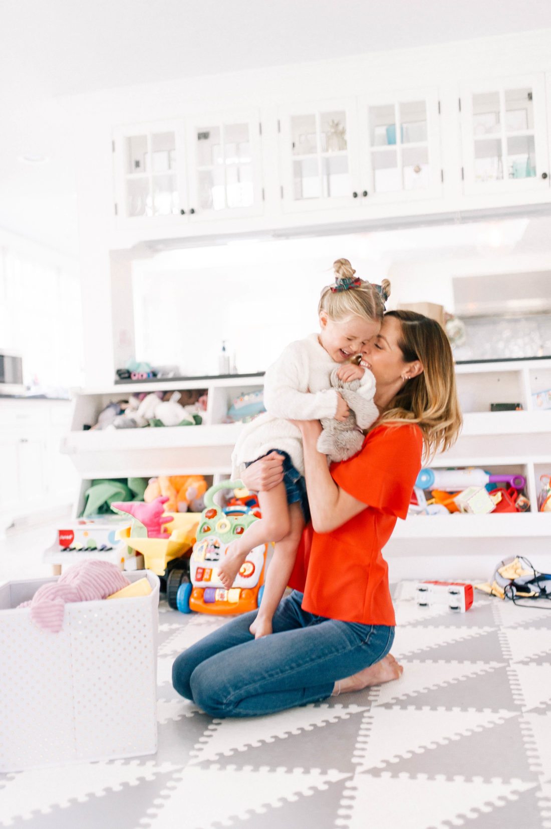 Eva Amurri Martino hugs and tickles three year old daughter marlowe in the family room of their Connecticut home