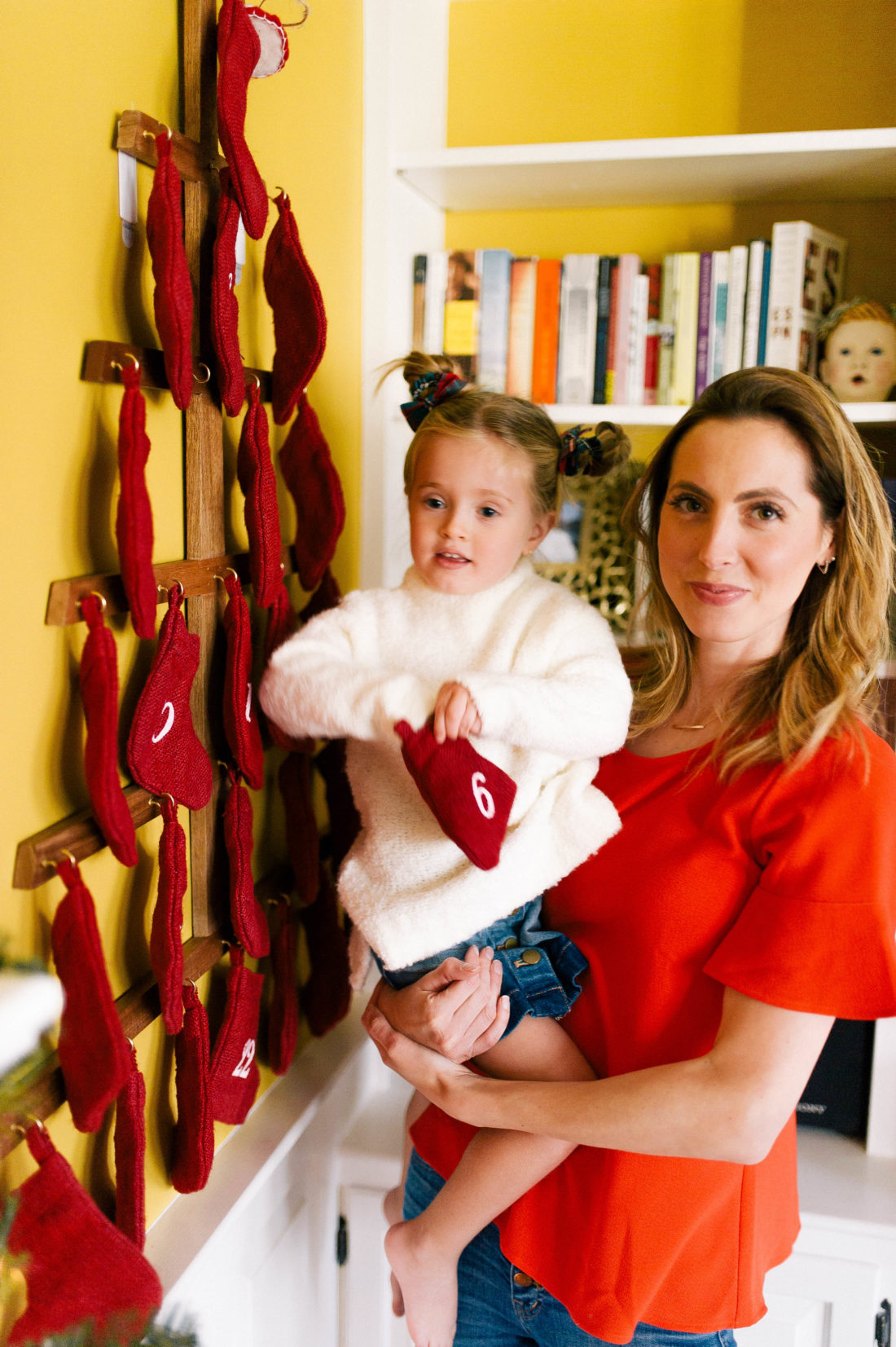 Eva Amurri Martino helps three year old daughter Marlowe unwrap a day of her Advent Calendar