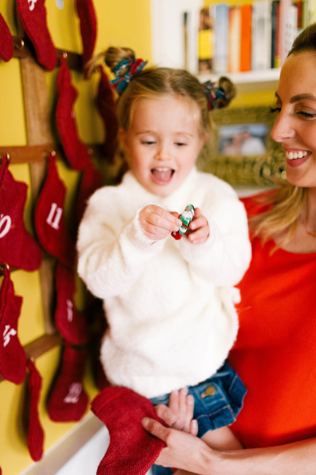 Marlowe Martino unwraps a piece of chocolate from her advent calendar