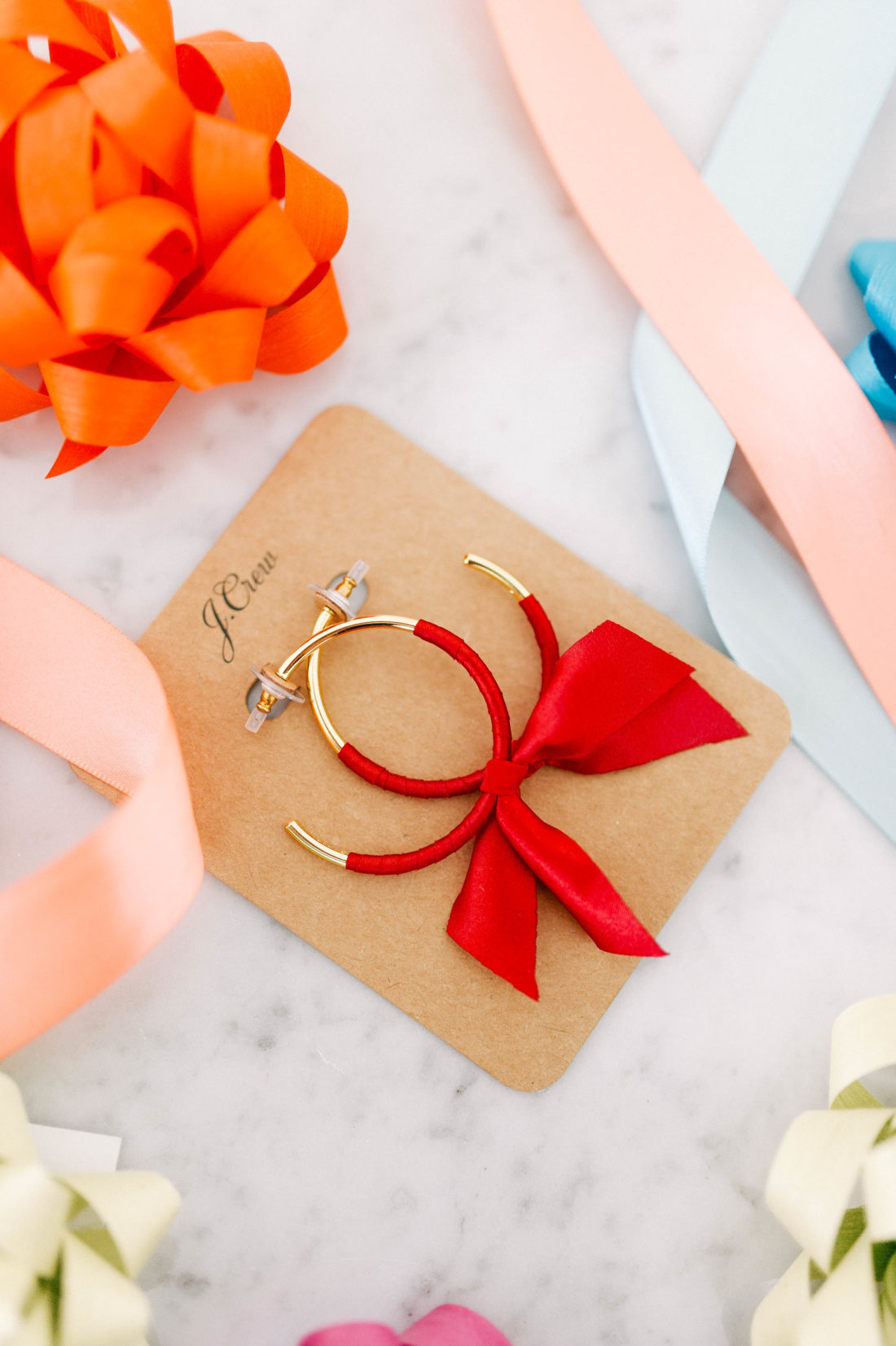 Eva Amurri Martino shares her roundup of favorite products for December, including this pair of ribbon accented hoop earrings