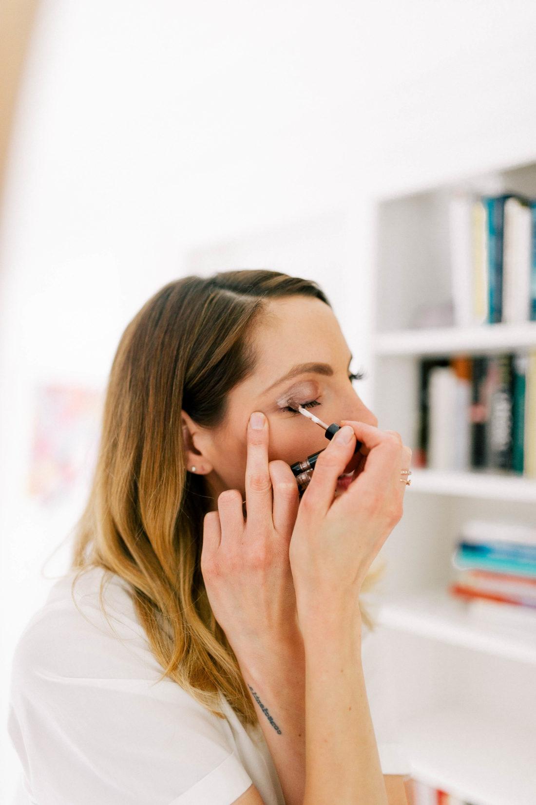 Eva Amurri Martino applies metallic liquid shimmer shadow to her eyelids to demonstrate one of her favorite holiday makeup looks