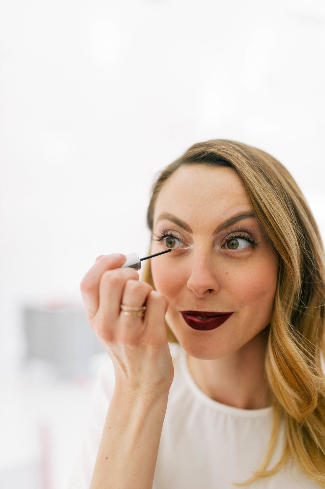 Eva Amurri Martino applies glitter eyeliner to the innter corners of her eyes