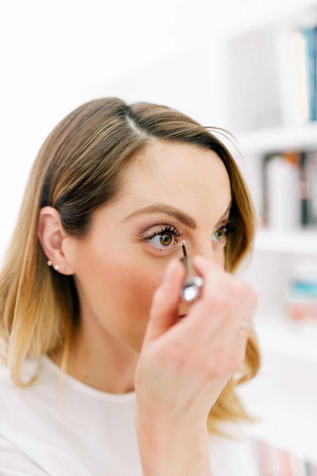 Eva Amurri Martino applies glitter eyeliner to the innter corners of her eyes