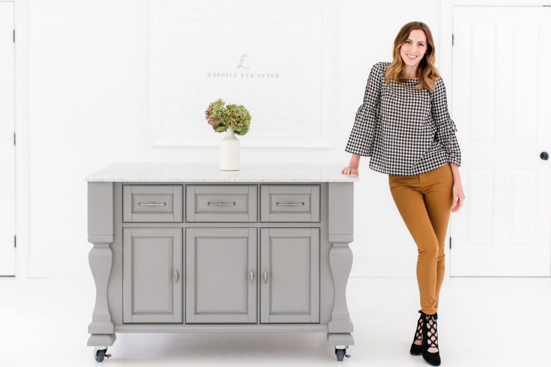Eva Amurri Martino stands at the marble topped island in the Happily Eva After photography studio