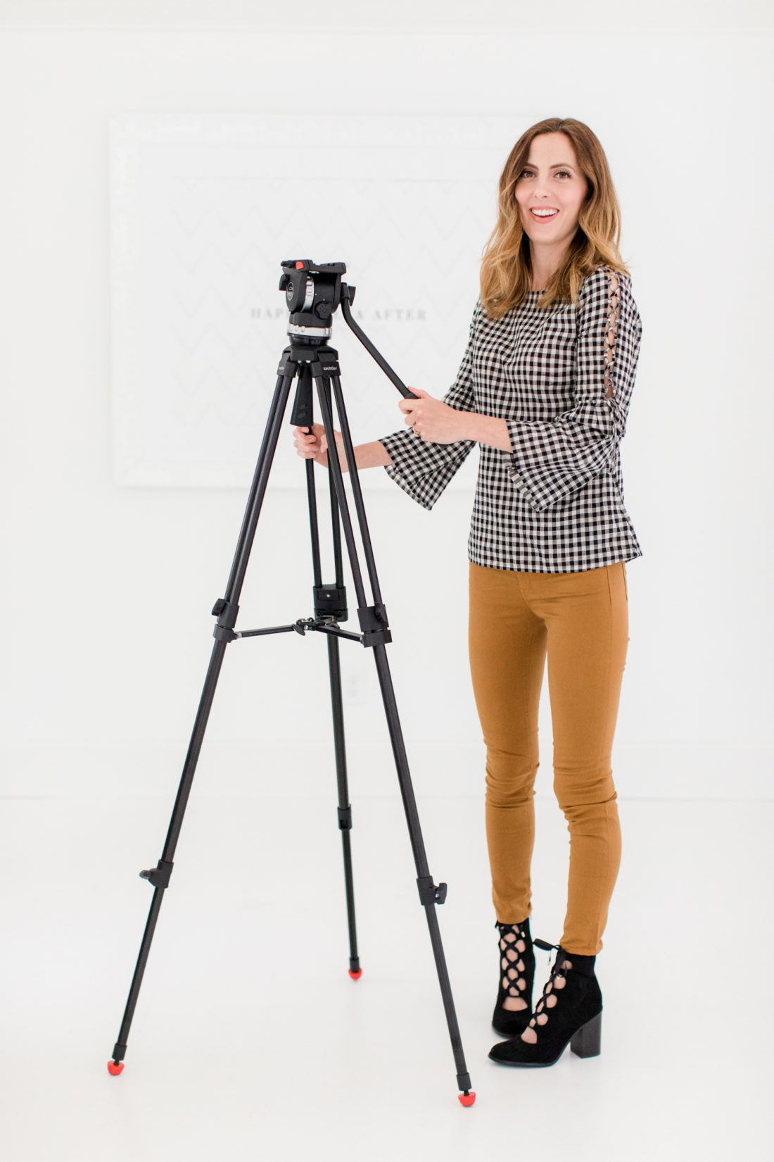 Eva Amurri Martino stands with her camera tripod in the Happily Eva After studio in Connecticut