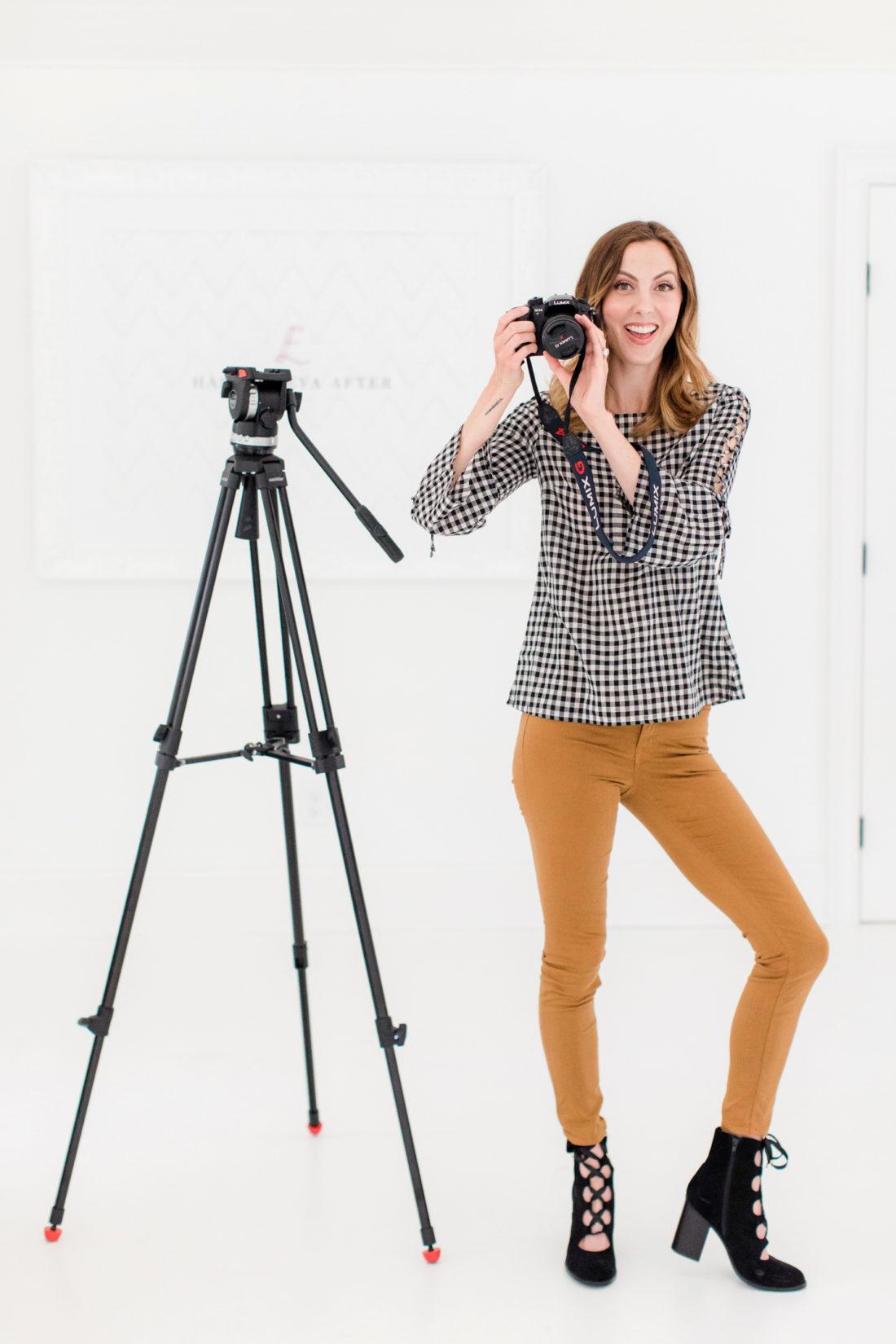 Eva Amurri Martino stands in her photography studio with her camera equipment