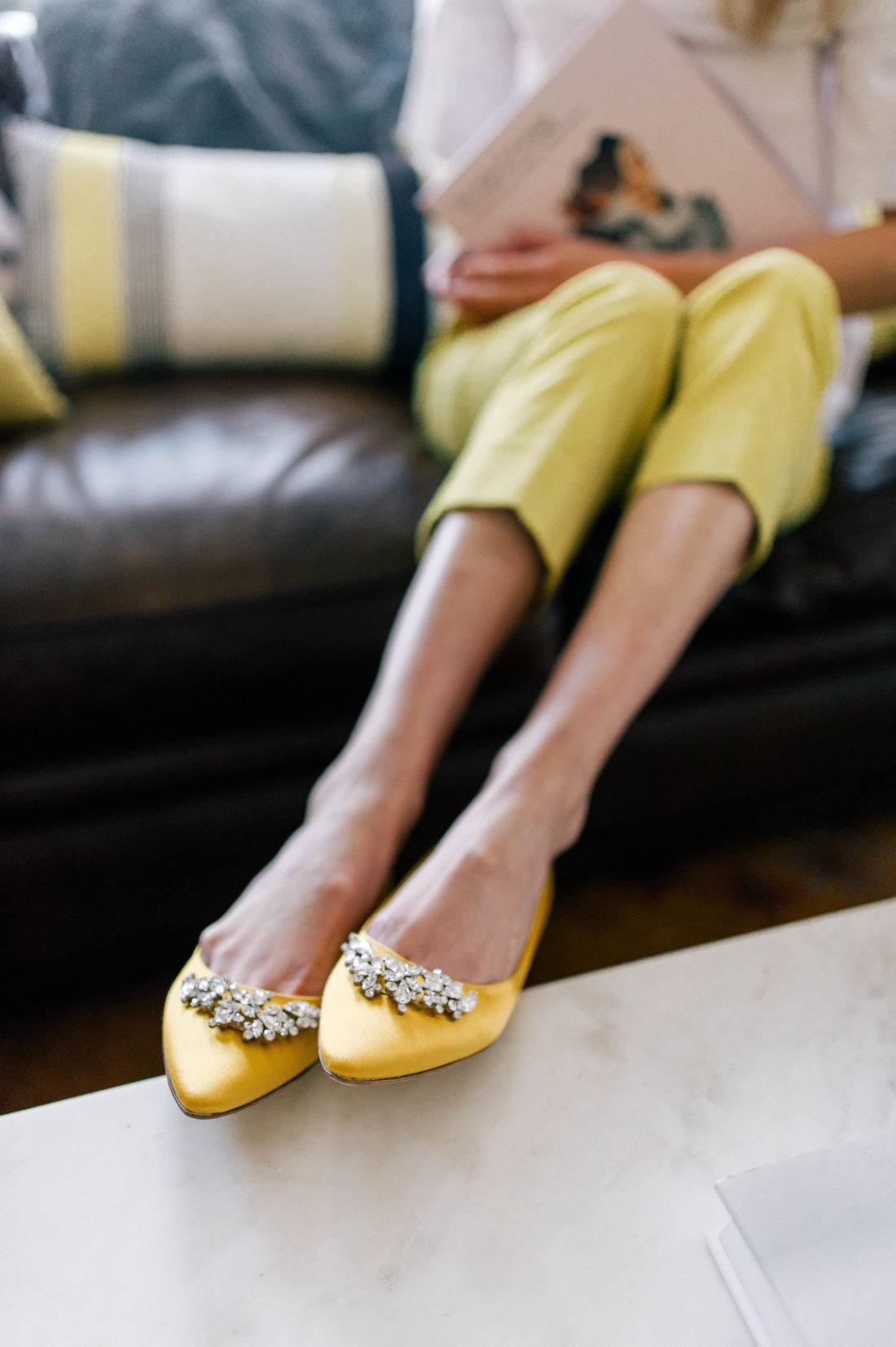 Eva Amurri Martino wears a pair of canary yellow manolo blahnik flats in the formal living room of her Connecticut home