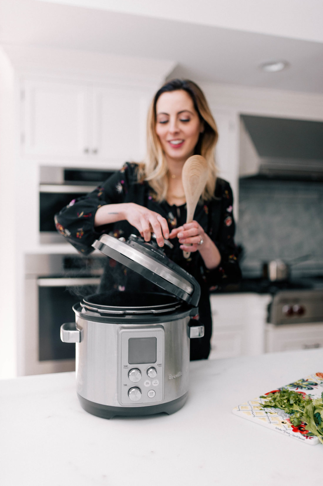 Eva Amurri Martino opens her slow cooker where she has been preparing meatballs