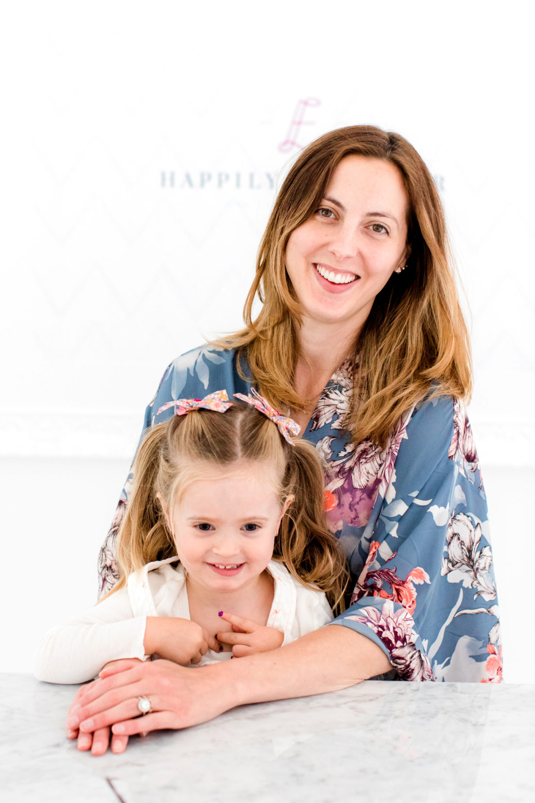 Eva Amurri martino sits with daughter, Marlowe, as she prepares to apply her makeup for a blog photo shoot