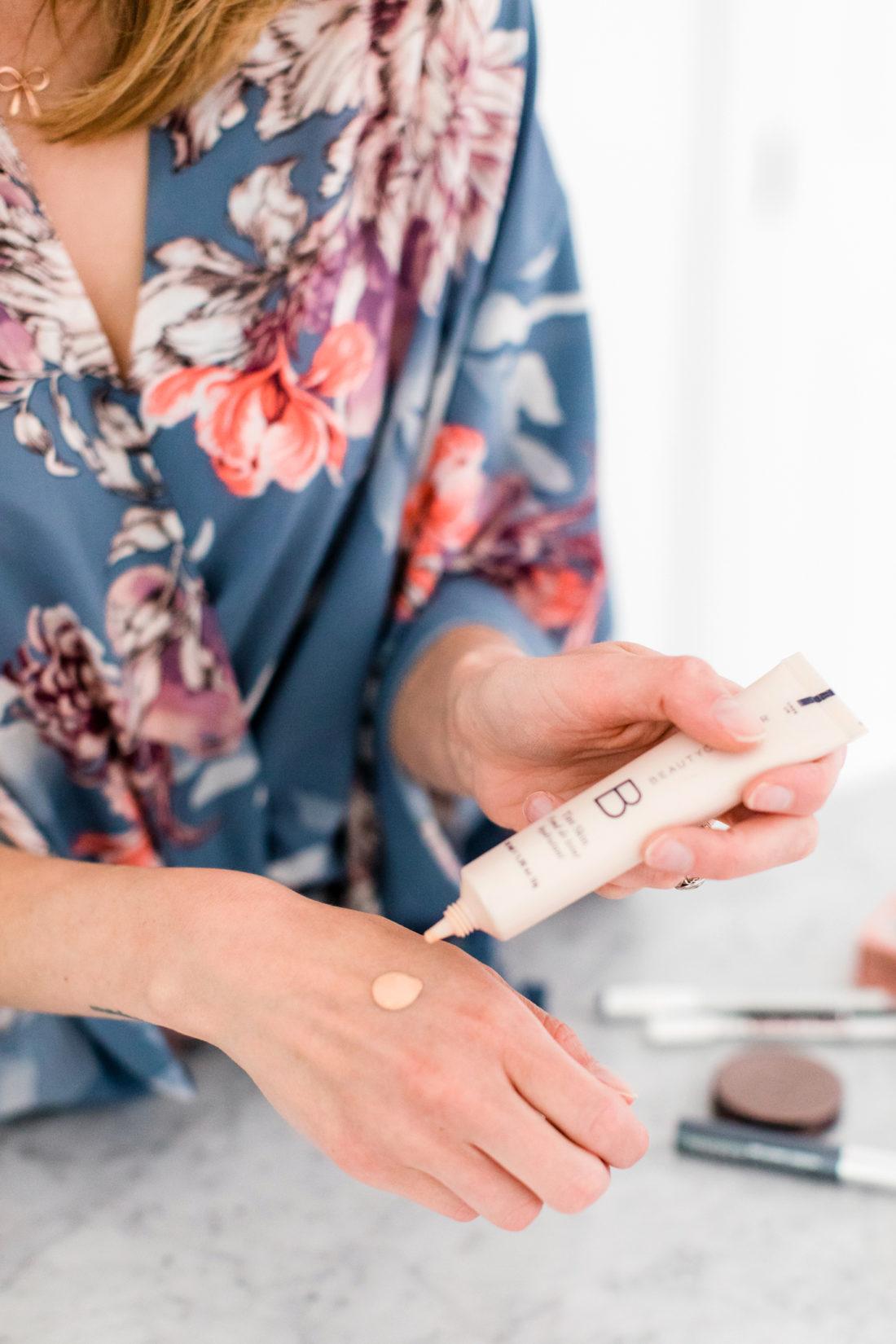 Eva Amurri martino applies a lightweight foundation as part of her photo shoot makeup tutorial