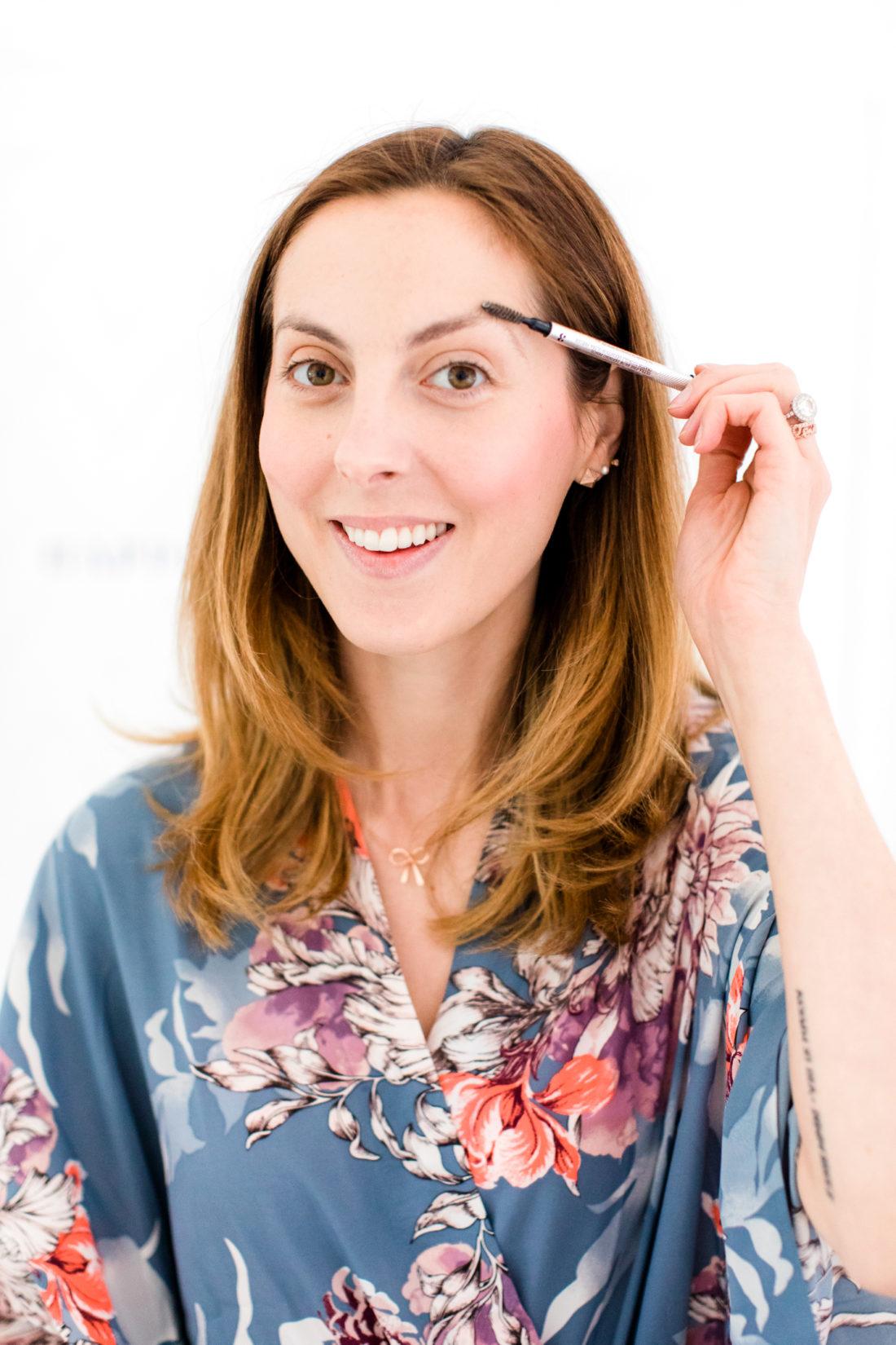 Eva Amurri Martino brushes her brows before applying brow pencil