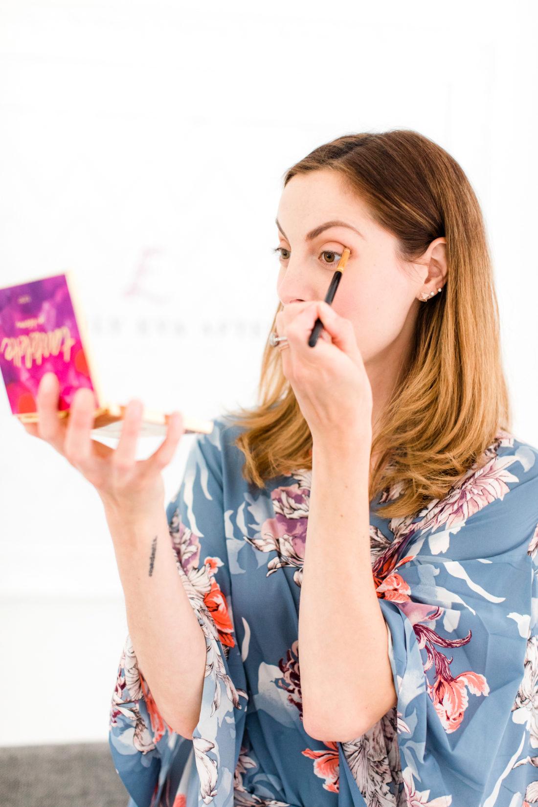 Eva Amurri Martino applies eyeshadow to the outer crease of her eye