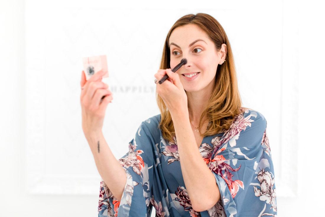 Eva Amurri Martino applies highlighter to the bridge of her nose