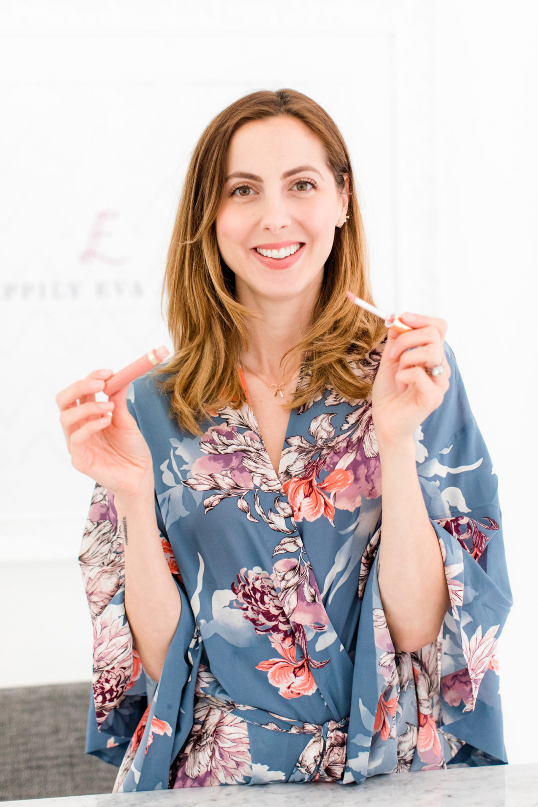 Eva Amurri Martino applies a light sweep of Beauty Counter lipgloss to add shine to her lips