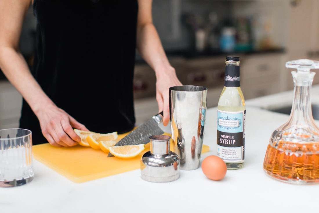 Eva Amurri Martino cuts a lemon as preparation for a whiskey sour