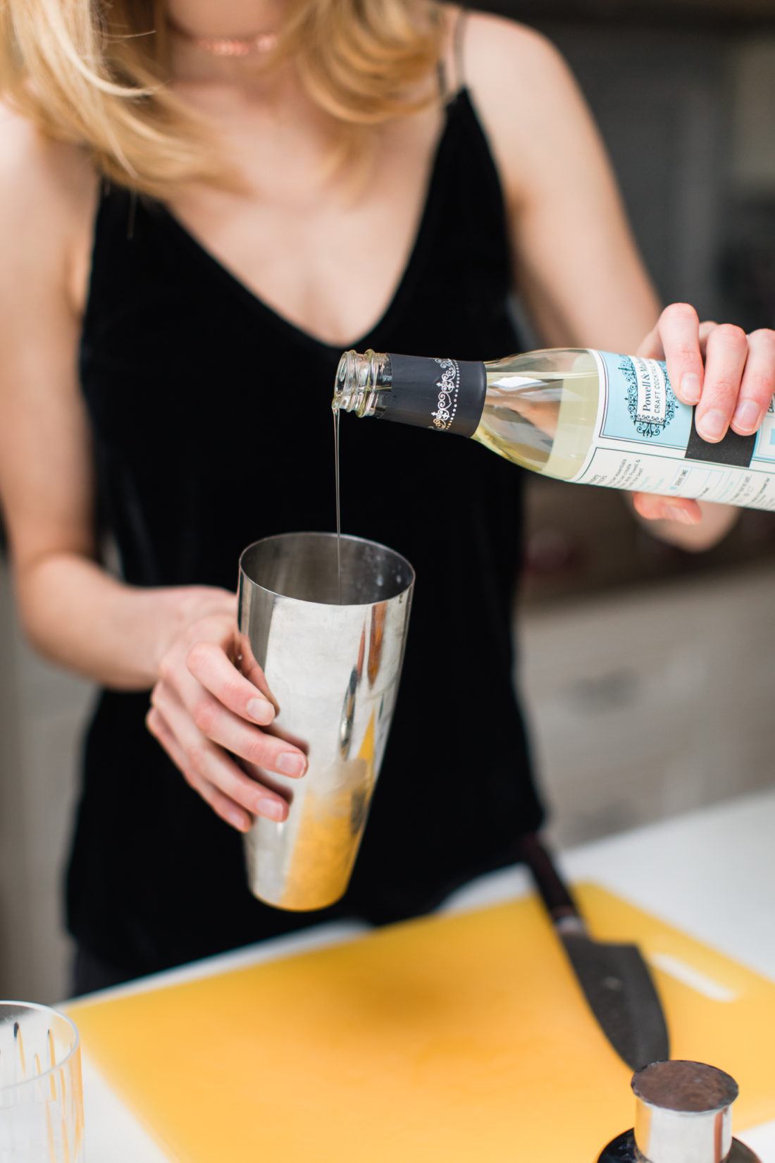 Eva Amurri Martino adds simple syrup to a whiskey sour