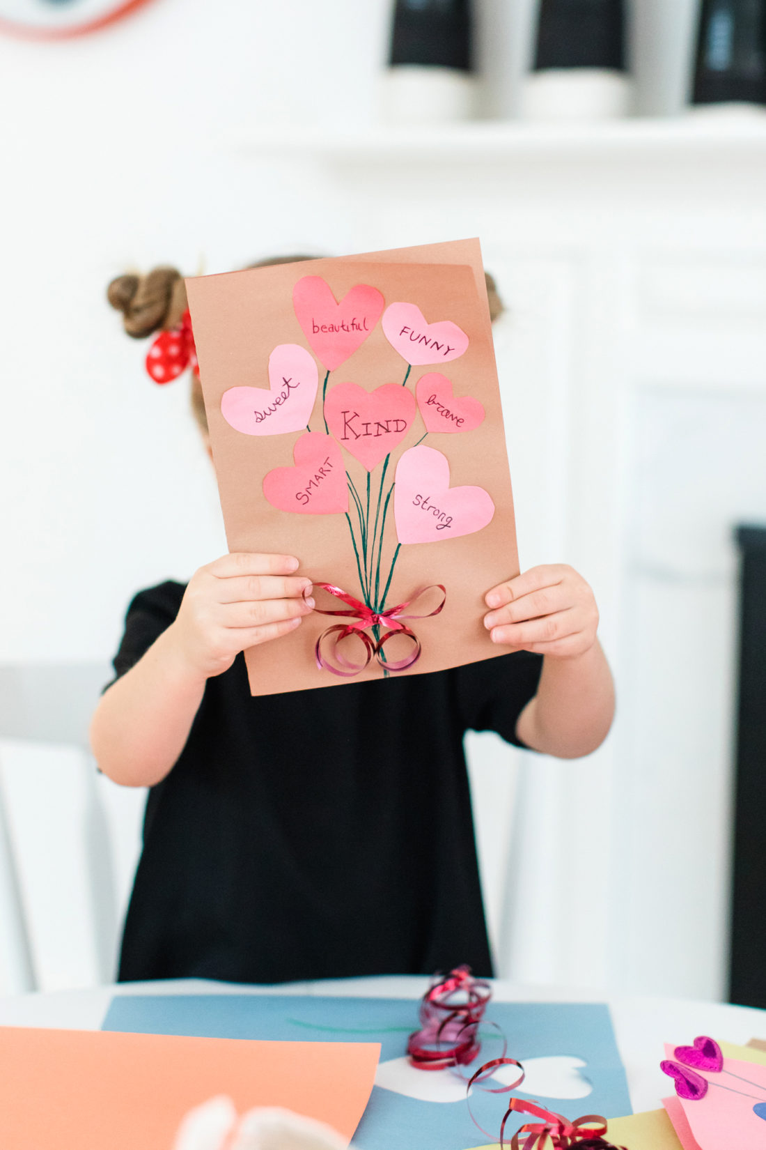 Marlowe Martino shares a homemade Valentine's Day card featuring a cutout heart bouquet on the front