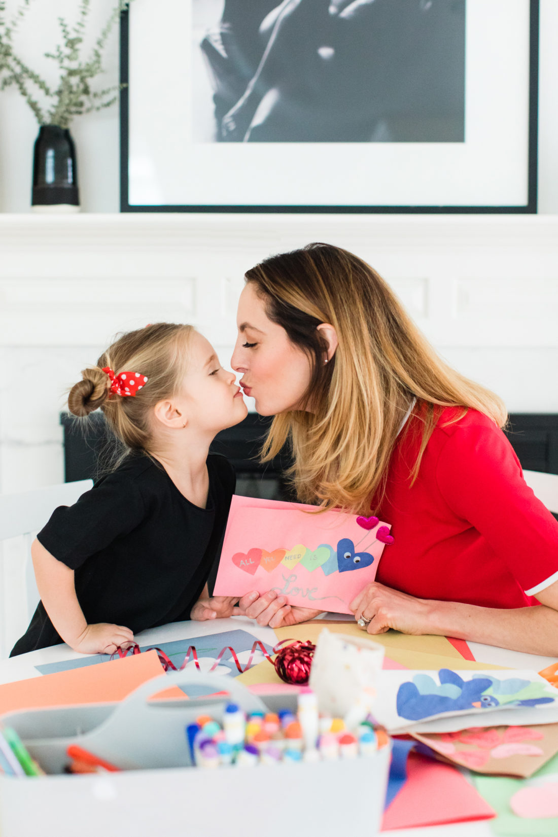 Eva AMurri Martino kisses three year old daughter Marlowe while they make Valentine's Day cards together
