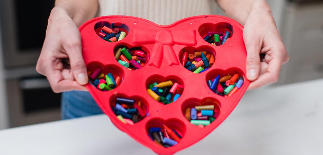 Eva Amurri Martino prepares to make crayon hearts out of bits of broken crayons in a heart mold