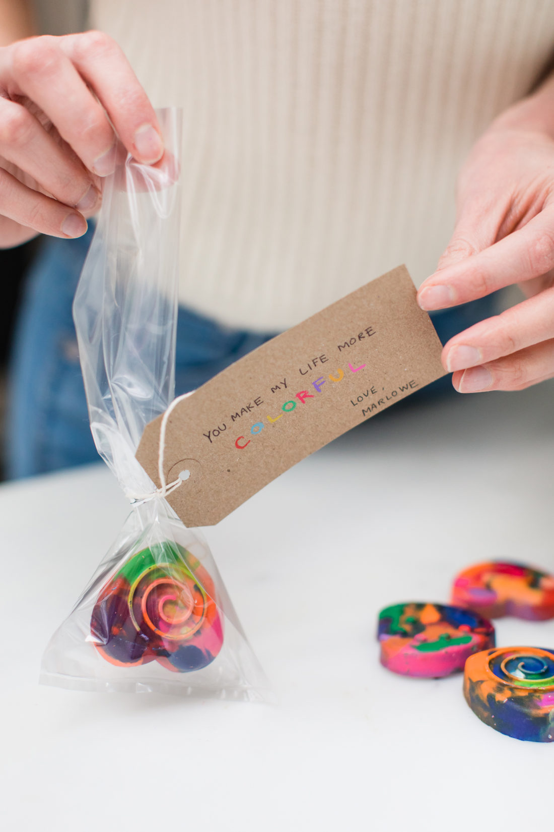 Eva Amurri Martino wraps up home made multicolored heart shaped crayons as Valentine's Day Favors for her daughter's class
