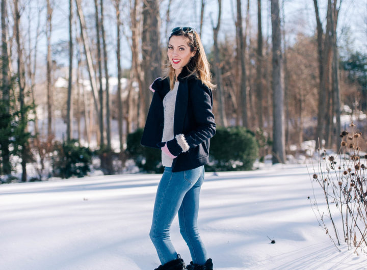 Eva Amurri Martino stands in the snow outside her Connecticut home wearing blue jeans, a sweater, navy pea coat, and black snow boots