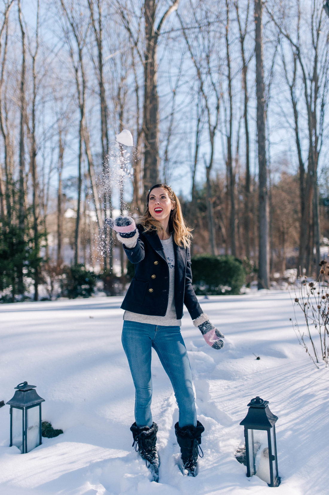 Eva Amurri Martino throws a snowball in to the air in the snowy yard outside her Connecticut home