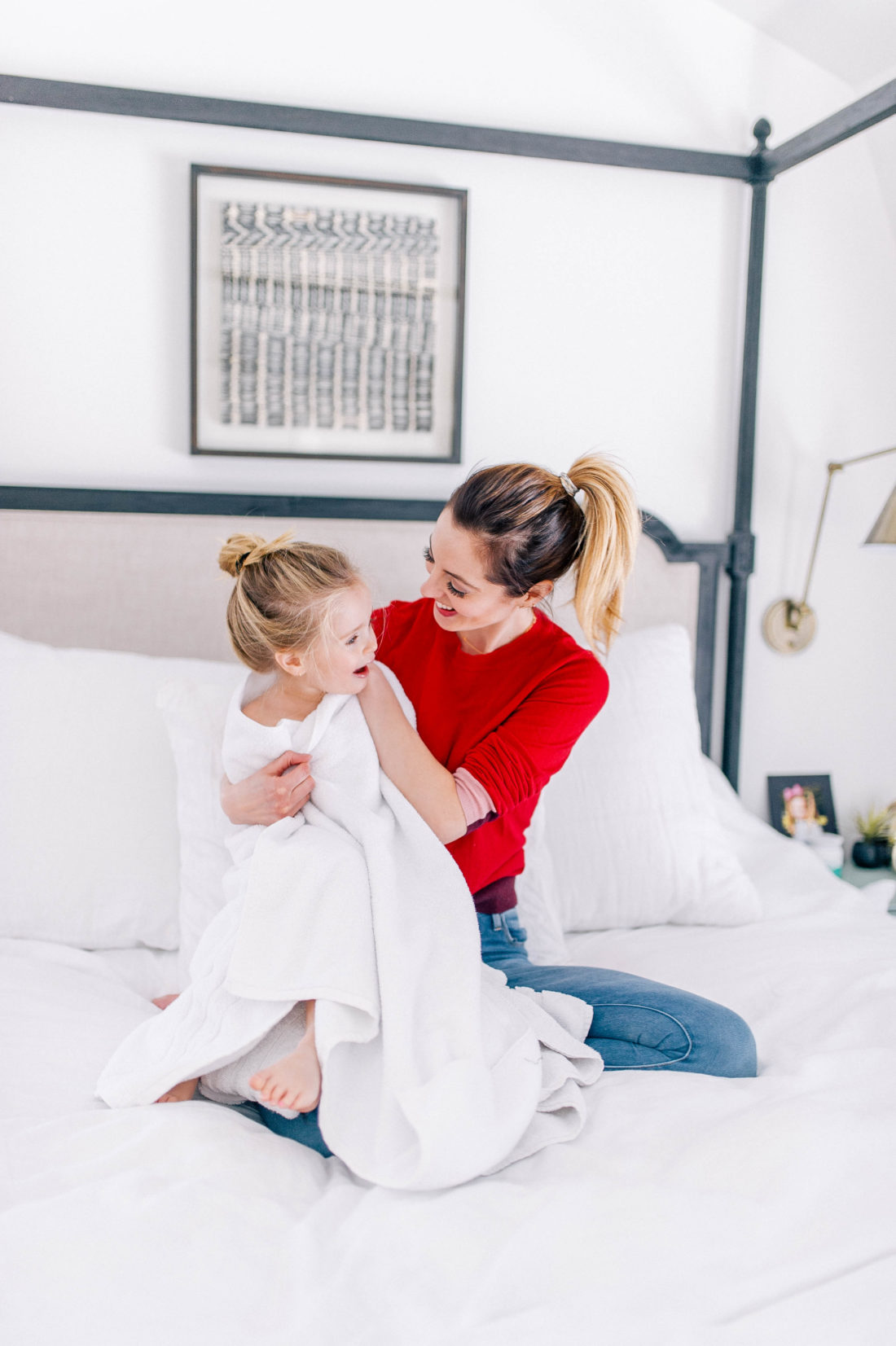 Eva Amurri Martino wraps daughter Marlowe in a white towel in the bedroom of her Connecticut home