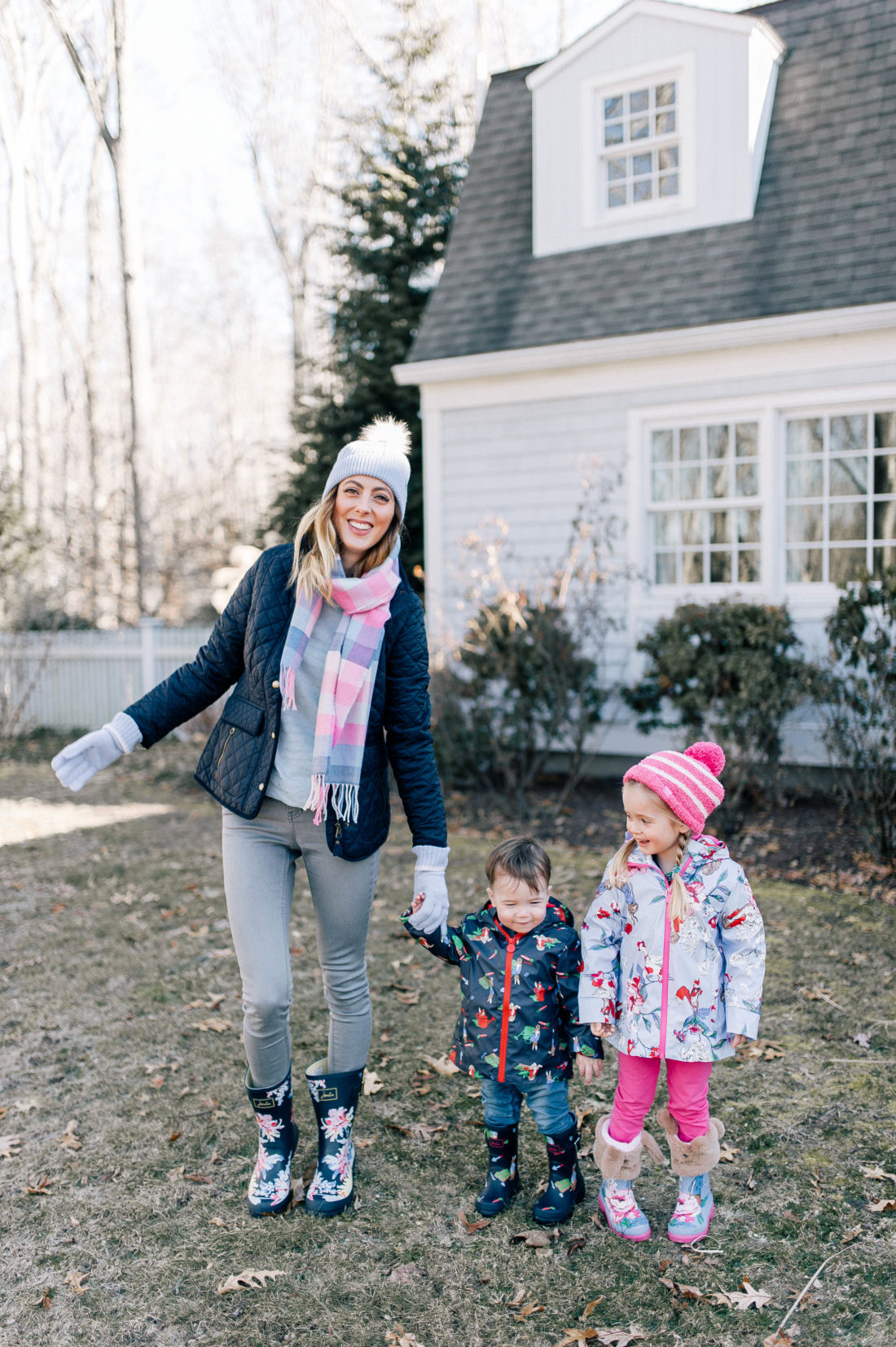 Eva Amurri Martino is bundled up in Peter Rabbit themed clothes with her two children playing outside of their connecticut home