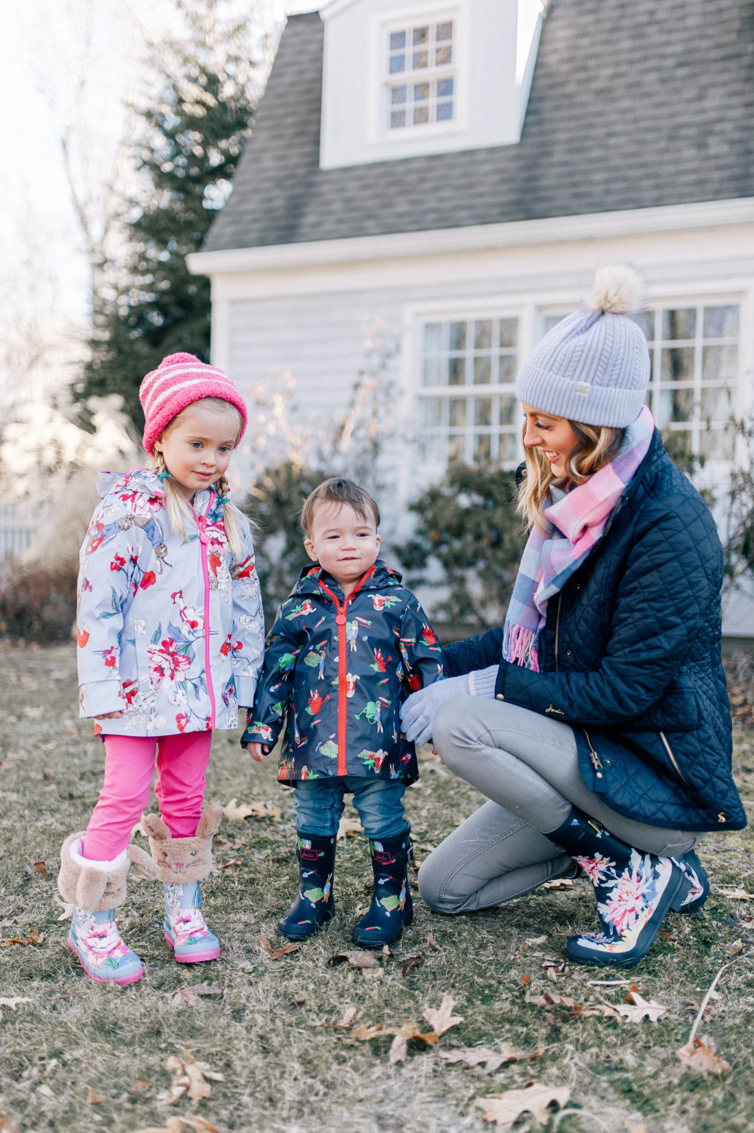 Eva Amurri Martino gets her two children bundled up in rain boots and coats to play outside of their Connecticut home