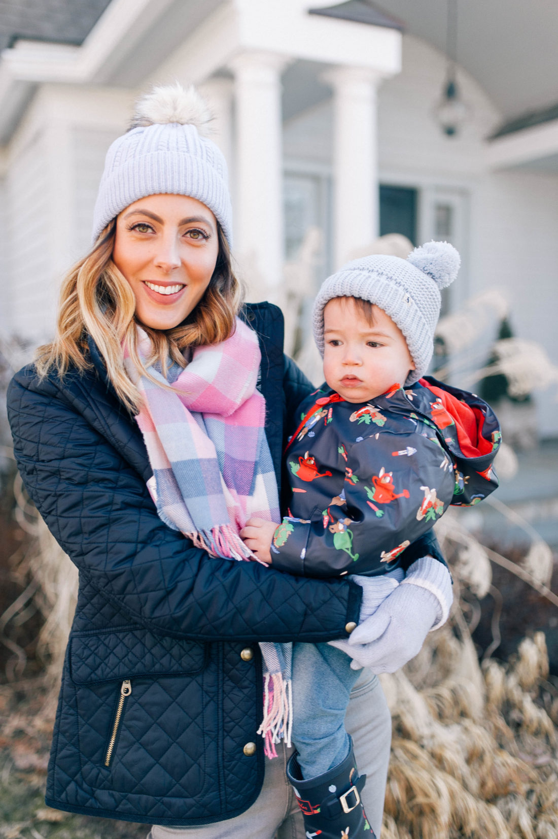 Eva Amurri Martino holds one year old son Major and walks through the garden of her Connecticut home