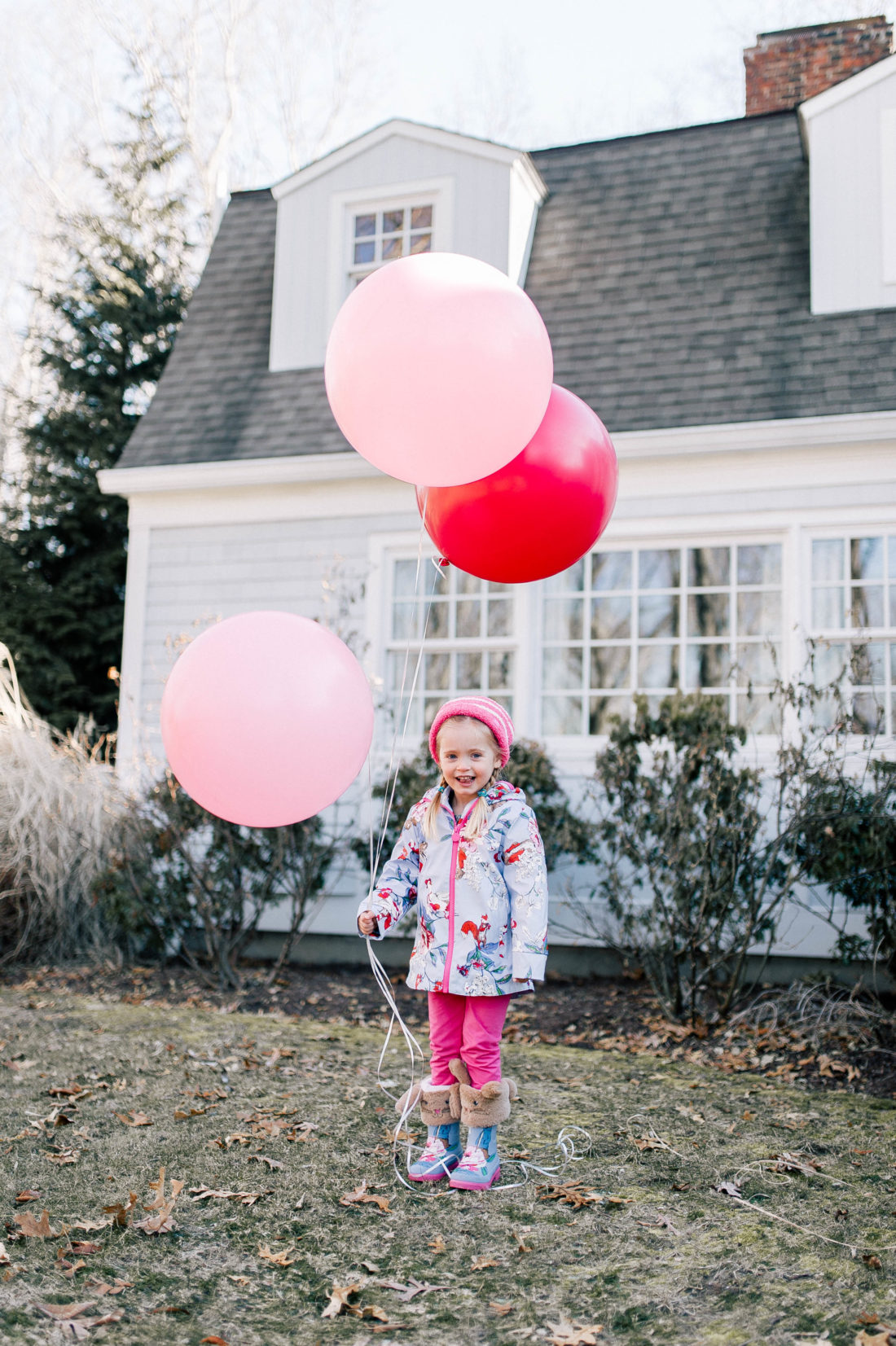 Marlowe Martino frolics through the garden of her Connecticut home holding balloons and wearing a Peter Rabbit themed outfit