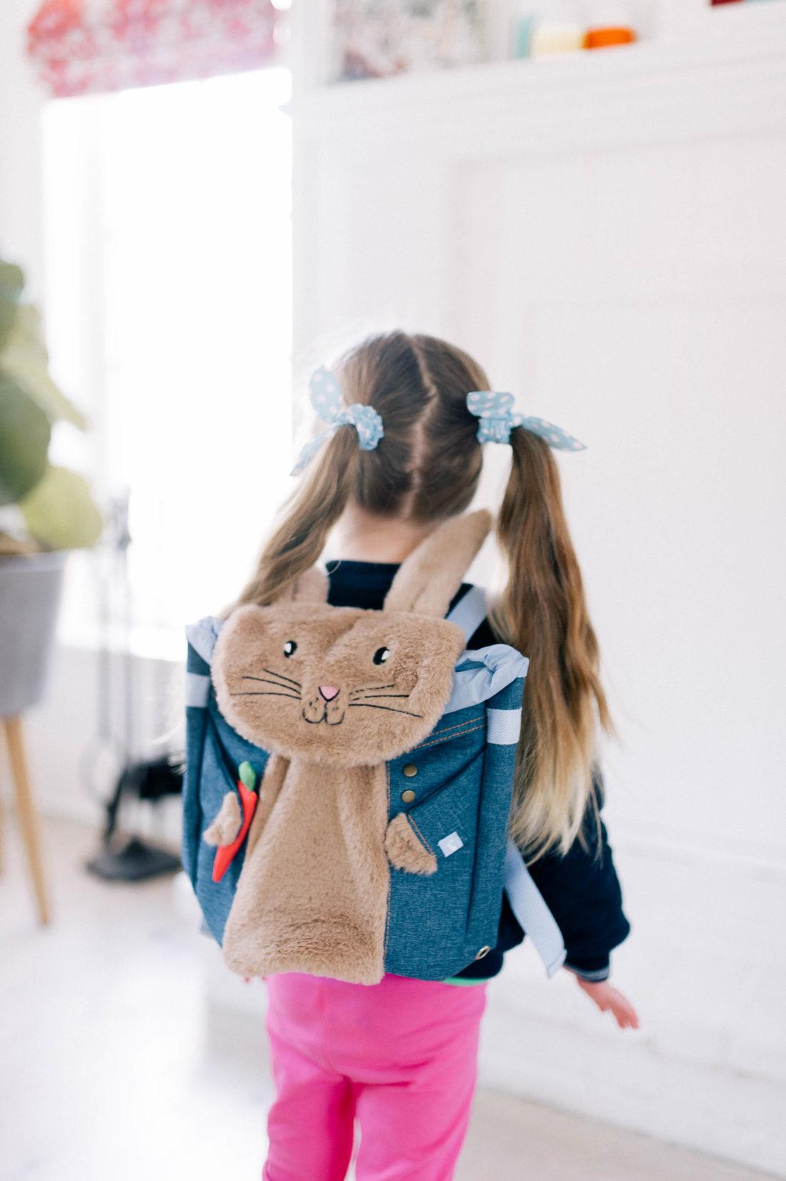 Marlowe Martino wears a fuzzy Peter Rabbit backpack