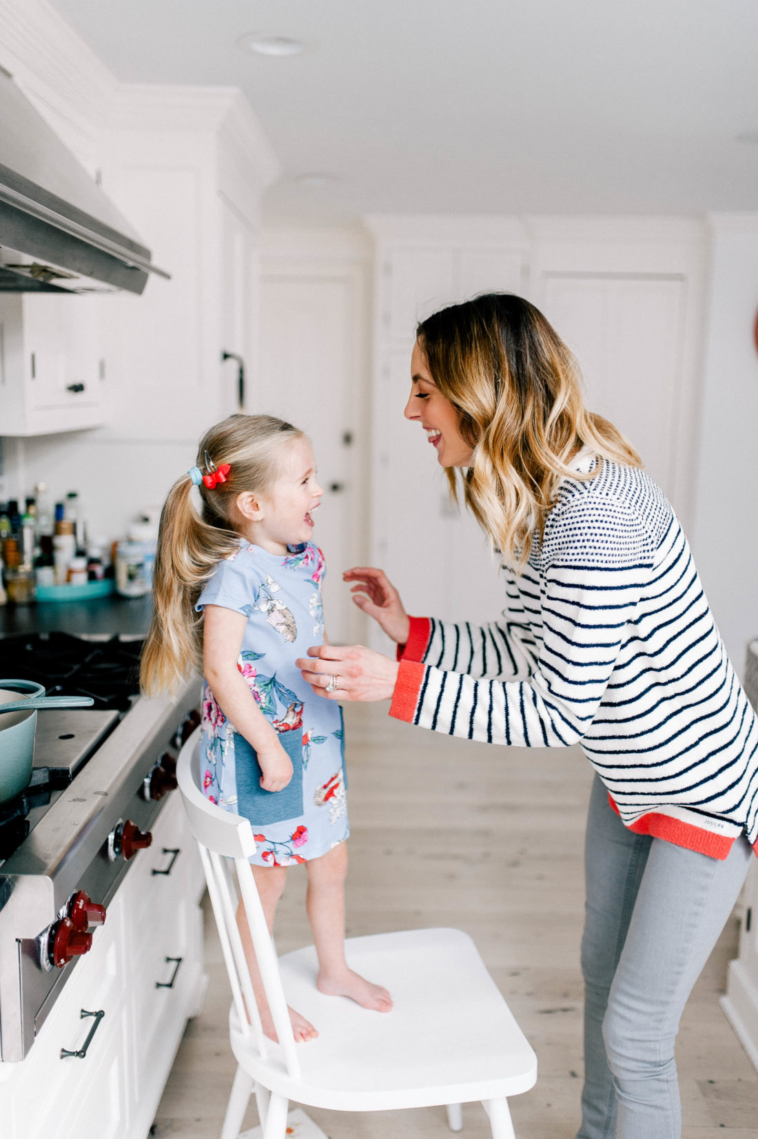 Eva Martino tickles Marlowe in the kitchen of their Connecticut home