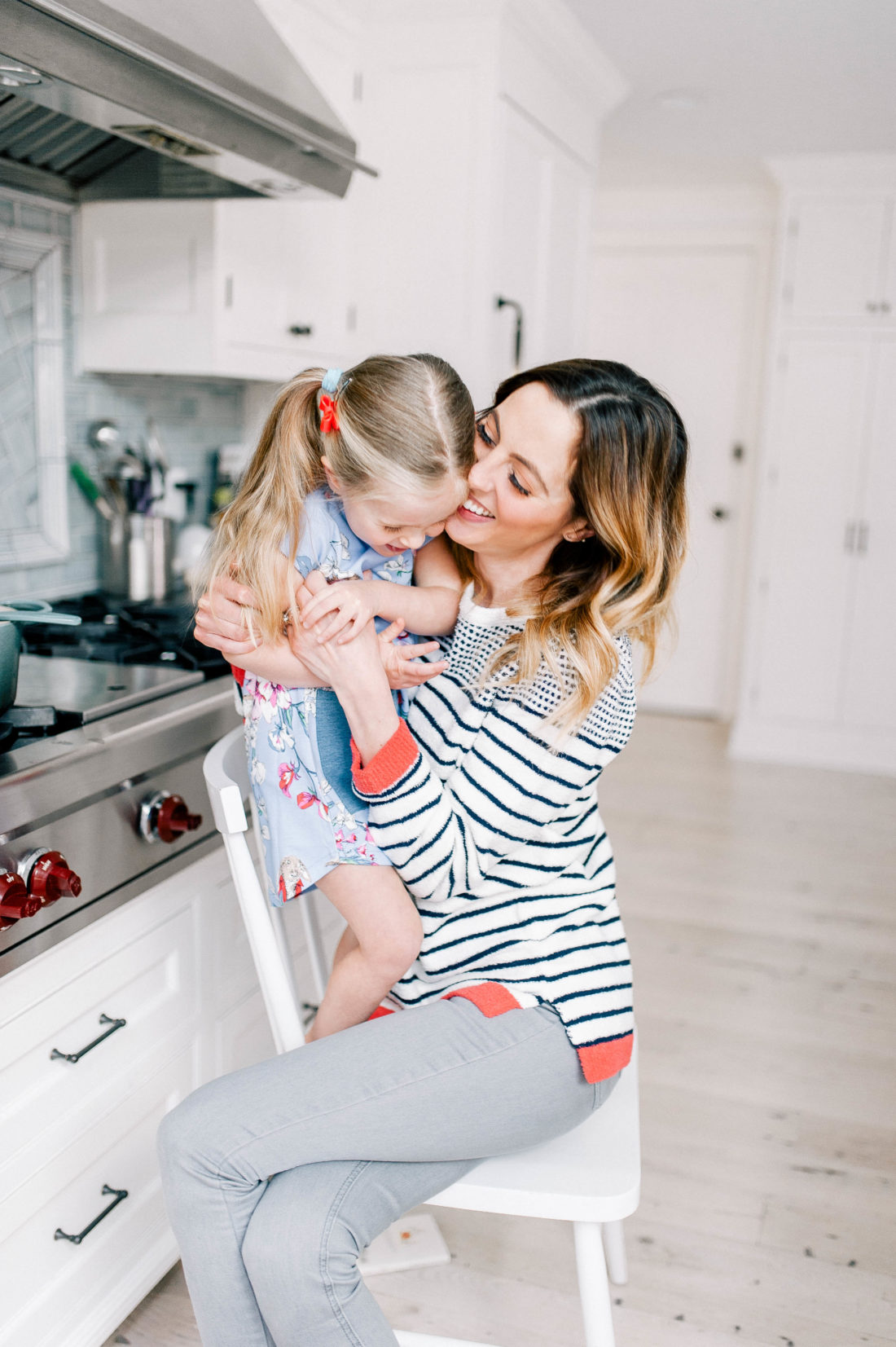 Eva Amurri Martino and Marlowe Martino laugh in the kitchen of their connecticut home