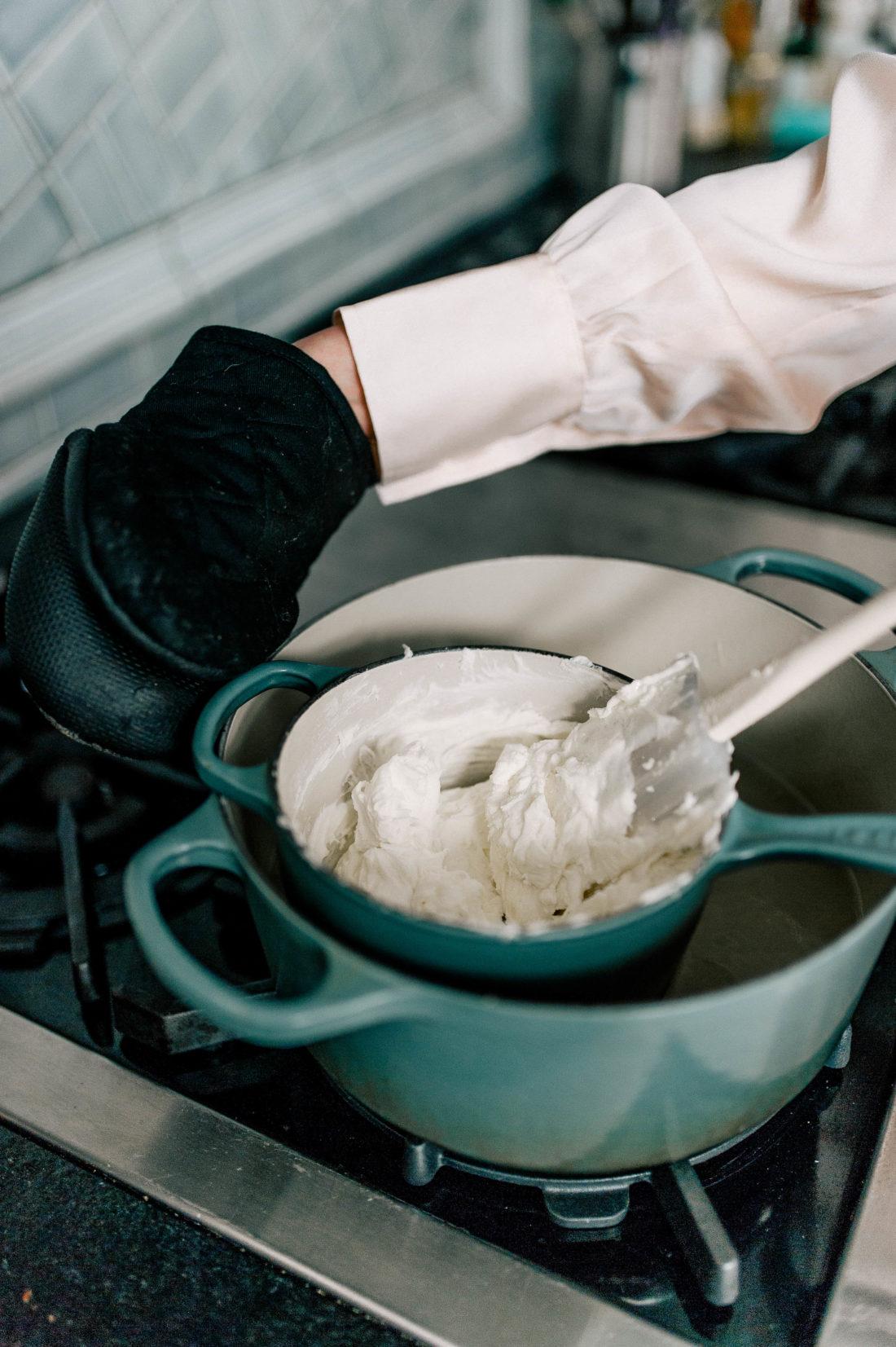 Eva Amurri Martino melts white chocolate to dip pretzels in for Valentine's Day