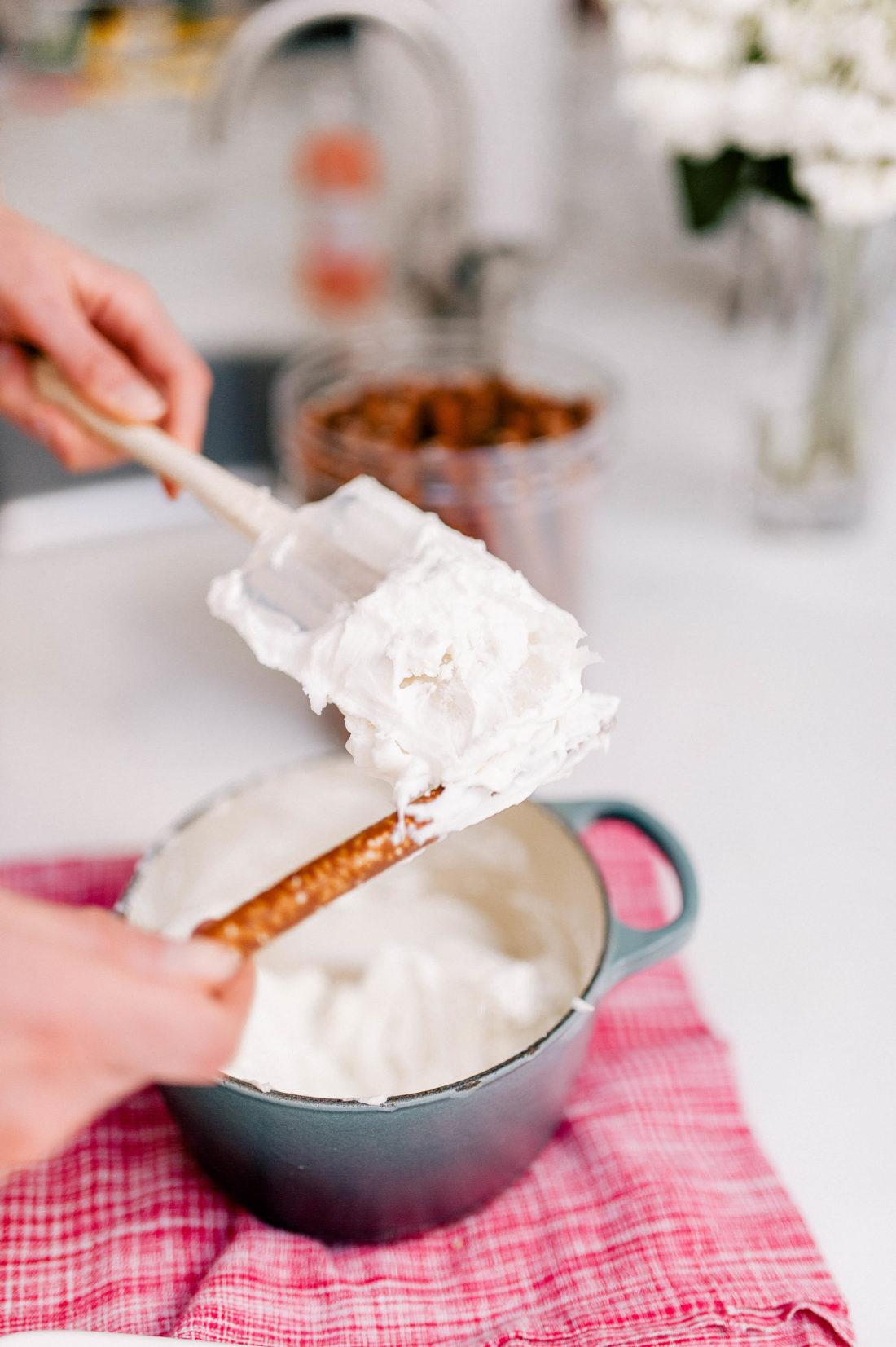Eva Amurri Martino spreads white chocolate on a pretzel rod as part of a Valentine's Day treat