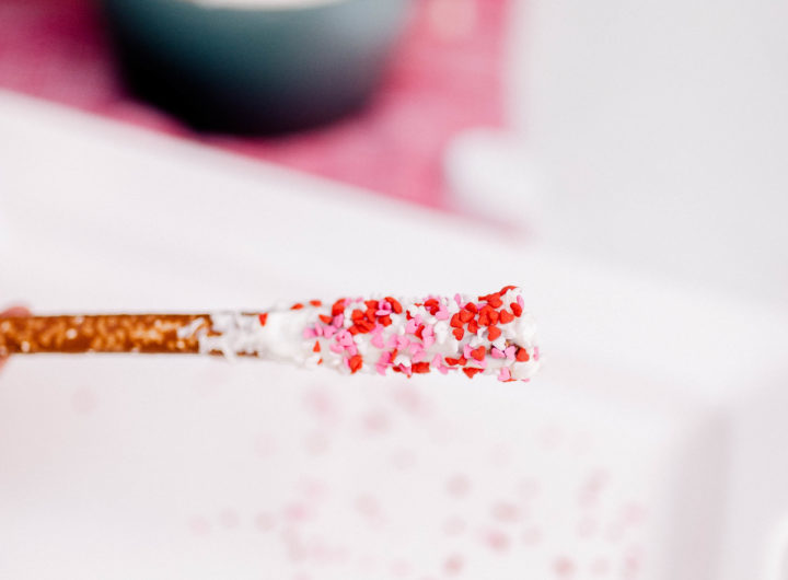 Valentine's Day sprinkles on a chocolate covered pretzels